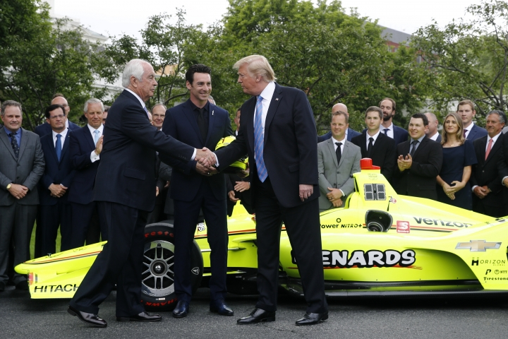 President Donald Trump shakes hands with team owner Roger Penske, left, and driver Simon Pagenaud on the South Lawn at the White House, Monday, June 10, 2019, in Washington during an event to honor Team Penske for the 2019 Indianapolis 500 win. (AP Photo/Patrick Semansky)