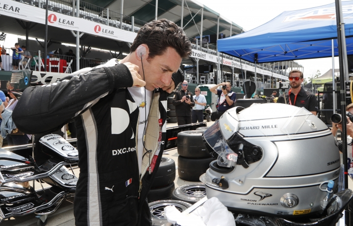 CORRECTS ID TO SIMON PAGENAUD, OF FRANCE, NOT ALEXANDER ROSSI - Simon Pagenaud, of France, suits up for a practice session for the first race of the IndyCar Detroit Grand Prix auto racing doubleheader, Friday, May 31, 2019, in Detroit. (AP Photo/Carlos Osorio)