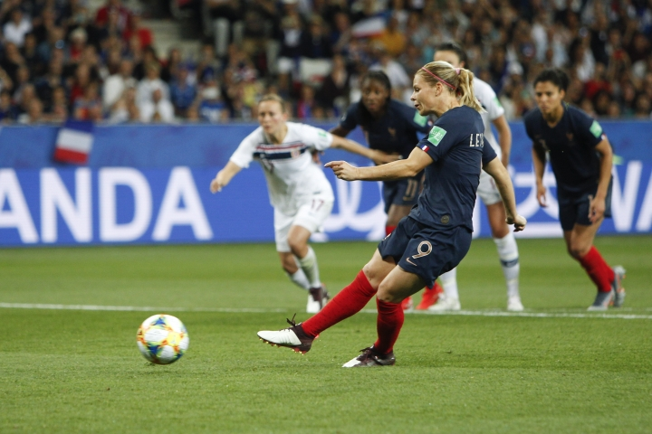 France's Eugenie Le Sommer scores her side's second goal on a penalty kick during the Women's World Cup Group A soccer match between France and Norway in Nice, France, Wednesday, June 12, 2019. (AP Photo/Claude Paris)