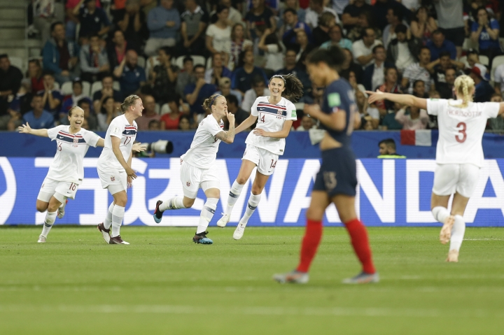 Norway's players celebrate after an own goal by France's Wendie Renard, foreground, during the Women's World Cup Group A soccer match between France and Norway in Nice, France, Wednesday, June 12, 2019. (AP Photo/Claude Paris)