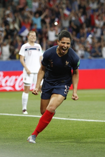 France's Valerie Gauvin, right, celebrates after scoring her side's opening goal during the Women's World Cup Group A soccer match between France and Norway in Nice, France, Wednesday, June 12, 2019. (AP Photo/Claude Paris)