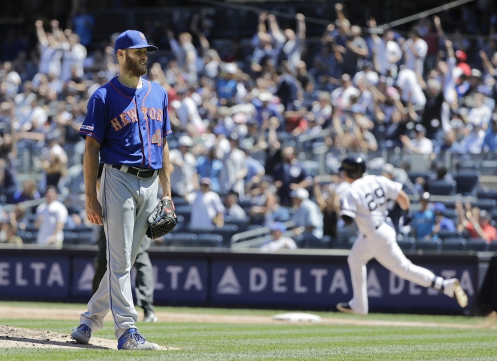 New York Mets starting pitcher Zack Wheeler, left, reacts as New York Yankees' Gio Urshela runs the bases after hitting a two-run home run during the fourth inning in the first baseball game of a doubleheader, Tuesday, June 11, 2019, in New York. (AP Photo/Frank Franklin II)