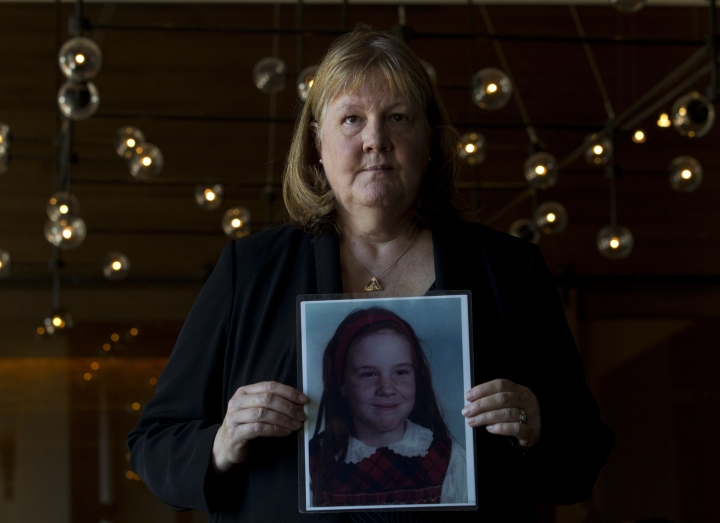 Becky Ianni, a victim of priest abuse, poses for a portrait with a picture of her younger self, during the United States Conference of Catholic Bishops 2019 Spring meetings in Baltimore, Tuesday, June 11, 2019. Ianni was 8-years-old when she says the priest of her family parish began to abuse her. (AP Photo/Jose Luis Magana)