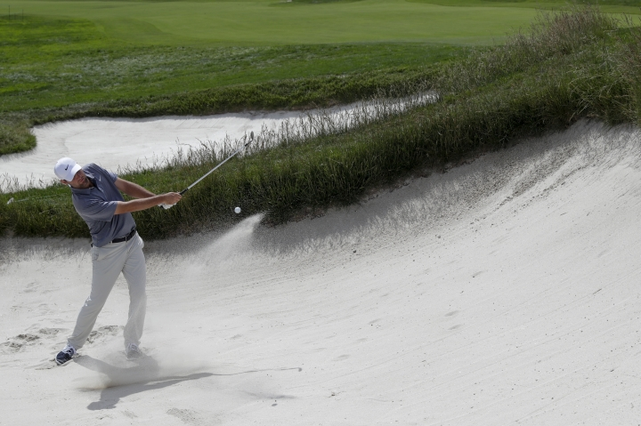 Brooks Koepka hits out of the bunker on the first hole during a practice round for the U.S. Open Championship golf tournament Tuesday, June 11, 2019, in Pebble Beach, Calif. (AP Photo/Matt York)