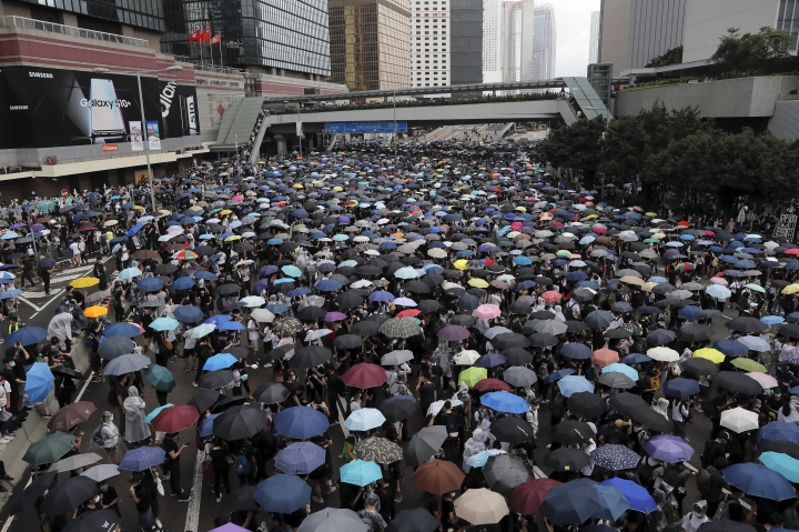 Protestors gather near the Legislative Council in Hong Kong, Wednesday, June 12, 2019. Hundreds of protesters surrounded government headquarters in Hong Kong on Wednesday as the administration prepared to open debate on a highly controversial extradition law that would allow accused people to be sent to China for trial. (AP Photo/Kin Cheung)
