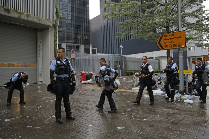 Riot police stand outside the Legislative Council in Hong Kong, Thursday, June 13, 2019. Traffic has been restored in the heart of Hong Kong a day after clashes between police and protesters who oppose legislation that would allow criminal suspects to be sent to mainland China for trial. (AP Photo/Kin Cheung)
