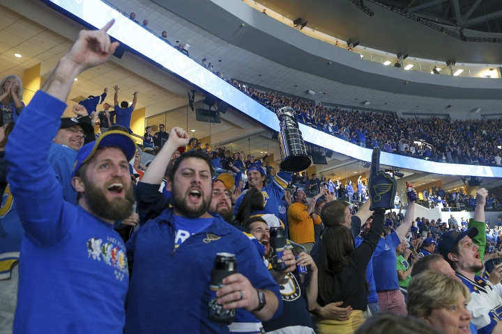 St. Louis Blues fans react during the final minutes of Game 7 of the team's NHL hockey Stanley Cup Final against the Boston Bruins in Boston, as they watch the broadcast of the game at Enterprise Center on Wednesday, June 12, 2019, in St. Louis. (AP Photo/Scott Kane)