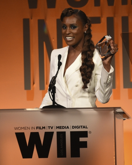 Issa Rae accepts the women in film emerging entrepreneur award at the Women in Film Annual Gala on Wednesday, June 12, 2019, at the Beverly Hilton Hotel in Beverly Hills, Calif. (Photo by Chris Pizzello/Invision/AP)