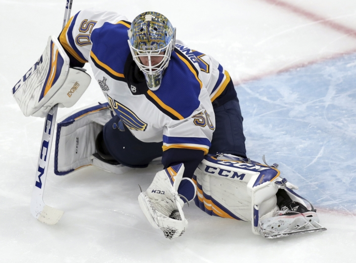 St. Louis Blues goaltender Jordan Binnington catches the puck during the third period in Game 7 of the NHL hockey Stanley Cup Final against the Boston Bruins, Wednesday, June 12, 2019, in Boston. (AP Photo/Charles Krupa)