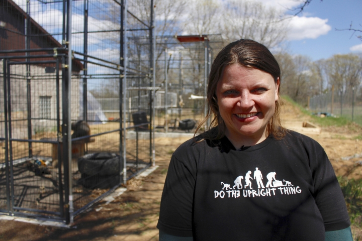 In this May 13, 2019, photo, Amy Kerwin stands outside the outdoor enclosures at Primates Inc., in Westfield, Wis. Kerwin started the sanctuary, which took its first monkeys in 2018. It now has five rhesus macaque monkeys that were previously used in medical research and one vervet monkey that used to be a pet. (AP Photo/Carrie Antlfinger)