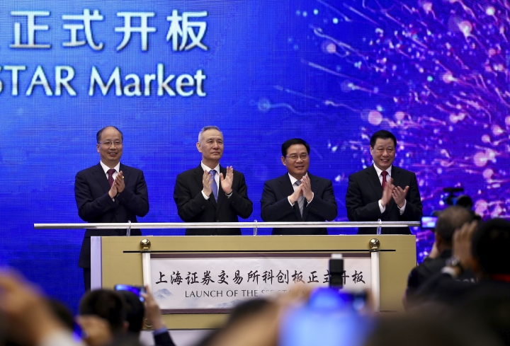 "From left; Yi Huiman, Chairman of China Securities Regulatory Commission, Chinese Vice Premier Liu He, Shanghai Party Secretary Li Qiang, Shanghai mayor and Ying Yong applaud during a ceremony for the launch of the SSE STAR Market, previously referred to as the Shanghai Science and Technology Innovation Board, in Shanghai, Thursday, June 13, 2019. Chinese media say the country's top trade negotiator has told a forum in Shanghai that ""external pressures"" can help the economy. (Chinatopix via AP)"