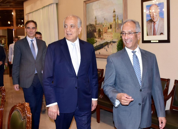 In this photo released by the Foreign Office, Pakistan's Foreign Ministry official Aftab Khokhar, right, escorts visiting Special Representative for Afghanistan Reconciliation Zalmay Khalilzad, center, for talks at the Foreign Office in Islamabad, Pakistan, Sunday, June 2, 2019. Khalilzad has met Pakistani officials to find a peaceful solution to neighboring Afghanistan's war. (Pakistan Foreign Office via AP)