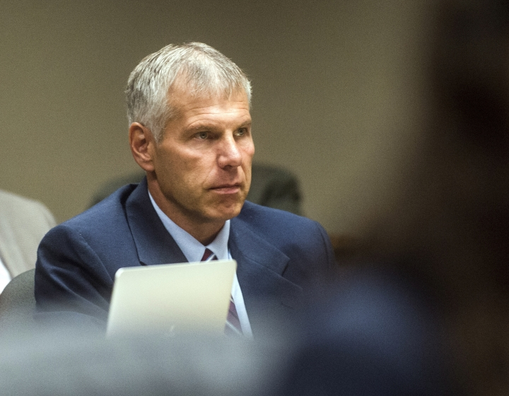 FILE--In this Aug. 22, 2018, file photo Patrick Cook listens on as Special Prosecutor Todd Flood questions U.S. Environmental Protection Agency whistleblower Miguel Del Toral, at the Genesee District Court in Flint, Mich. Prosecutors stunningly dropped all criminal charges against Cook, Thursday, June 13, 2019 and seven others in the Flint water scandal and pledged to start the investigation from scratch. (Jake May/The Flint Journal via AP)