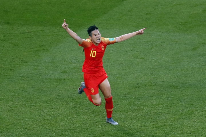 China's Li Ying, right, celebrates after scoring her side's opening goal during the Women's World Cup Group B soccer match between China and South Africa at the Parc des Princes in Paris, France, Thursday, June 13, 2019. (AP Photo/Thibault Camus)
