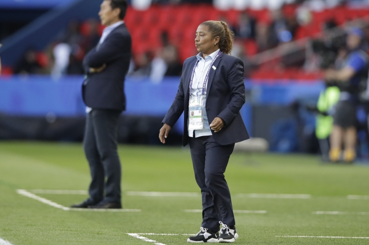 South Africa coach Desiree Ellis, right, and China head coach Jia Xiuquan, background, follow the action during the Women's World Cup Group B soccer match between China and South Africa at Parc des Princes in Paris, France, Thursday, June 13, 2019. (AP Photo/Alessandra Tarantino)