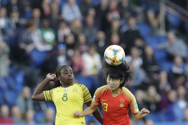 China's Wang Yan, right, heads the ball next to South Africa's Ode Fulutudilu during the Women's World Cup Group B soccer match between China and South Africa at Parc des Princes in Paris, France, Thursday, June 13, 2019. (AP Photo/Alessandra Tarantino)