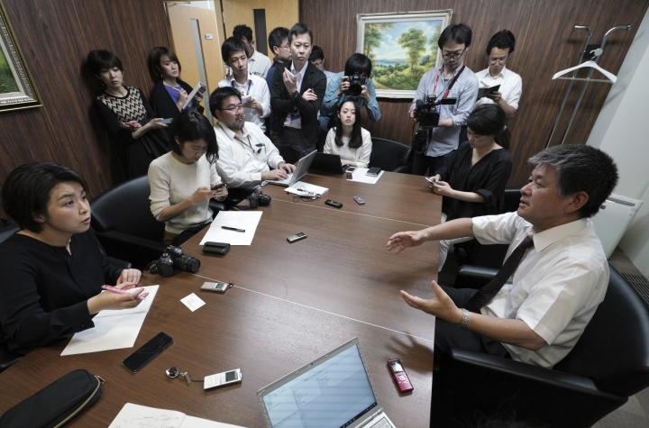 Michio Yube, right, director and general manager at the Kikuka Sankyo Co., LTD., speaks to media after one of their ships, the Kokuka Courageous, was attacked near the Strait of Hormuz, at Kikuka Sankyo Co., LTD. Thursday, June 13, 2019, in Tokyo. Two oil tankers near the strategic Strait of Hormuz were reportedly attacked on Thursday, an assault that left one ablaze and adrift as sailors were evacuated from both vessels and the U.S. Navy rushed to assist amid heightened tensions between Washington and Tehran. (AP Photo/Eugene Hoshiko)