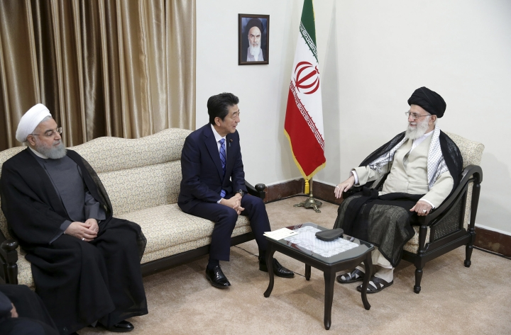 In this picture released by the official website of the office of the Iranian supreme leader, Supreme Leader Ayatollah Ali Khamenei, right, meets with Japanese Prime Minister Shinzo Abe, center, as Iranian President Hassan Rouhani sits at left, in Tehran, Iran, Thursday, June 13, 2019. A portrait of the late Iranian revolutionary founder Ayatollah Khomeini hangs on the wall. (Office of the Iranian Supreme Leader via AP)