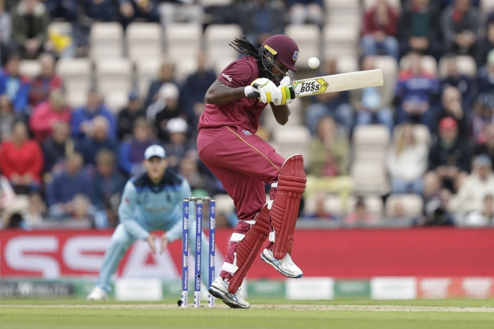 West Indies' Chris Gayle avoids a bouncer during the Cricket World Cup match between England and West Indies at the Hampshire Bowl in Southampton, England, Friday, June 14, 2019. (AP Photo/Matt Dunham)