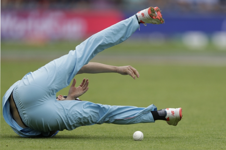 England's Mark Wood fails to hold a catch that would have taken the wicket of West Indies' Chris Gayle during the Cricket World Cup match between England and West Indies at the Hampshire Bowl in Southampton, England, Friday, June 14, 2019. (AP Photo/Matt Dunham)