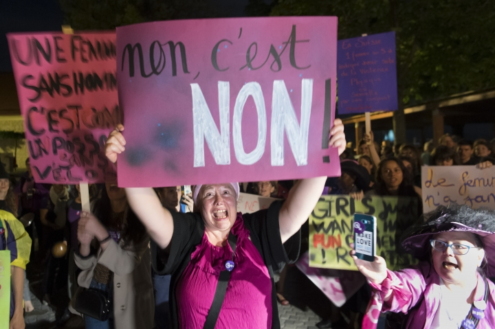 People protest during a nationwide women's strike on Friday, June 14, 2019, in Lausanne, Switzerland. There is list of several reasons motivating people to take part in the strike. These range from unequal wages to pressures on part-time employees, the burden of household work and sexual violence. (Laurent Gillieron/Keystone via AP)
