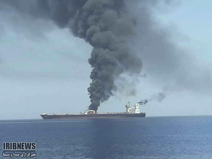 In this photo released by state-run IRIB News Agency, an oil tanker is on fire in the sea of Oman, Thursday, June 13, 2019. Two oil tankers near the strategic Strait of Hormuz have been reportedly attacked. The alleged assault on Thursday left one ablaze and adrift as sailors were evacuated from both vessels. The U.S. Navy rushed to assist amid heightened tensions between Washington and Tehran. (IRIB News Agency via AP)
