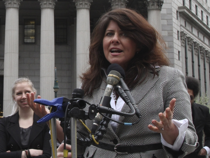 "FILE - In this March 29, 2012 file photo author and political consultant Naomi Wolf speaks to reporters during a news conference in New York. Wolf's U.S. publisher is postponing the release of her new book, ""Outrages,"" after a BBC interviewer challenged some of her findings. Wolf is openly objecting to the delay. Houghton Mifflin Harcourt announced that ""new questions"" had come up about ""Outrages,"" originally scheduled to come out next week. It already has been published in the United Kingdom. On Friday, June 14, 2019, Wolf tweeted that she made what she thought were the needed changes and that she believed her book's core findings remained valid. ""I strongly objected to this decision,"" she wrote.(AP Photo/Mary Altaffer)"