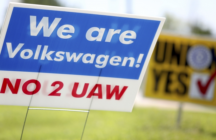 Signs for and against unionization are in a roundabout along Volkswagen Drive in front of the Volkswagen plant Friday, June 14, 2019 in Chattanooga, Tenn. Workers voted against forming a factory-wide union, handing a setback to the United Auto Workers' efforts to gain a foothold among foreign auto facilities in the South. (Erin O. Smith/Chattanooga Times Free Press via AP)