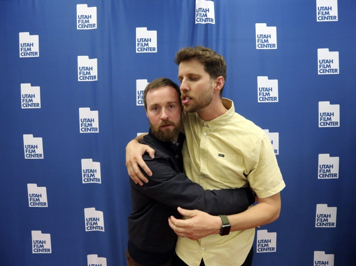 "In this May 3, 2019, photo, Aaron Ruell, who played the character Kip, left, and Jon Heder, who played Napoleon Dynamite, hug during a photo-op as they celebrate the 15th anniversary of the cult classic comedy ""Napoleon Dynamite,"" in Salt Lake City. (AP Photo/Rick Bowmer)"