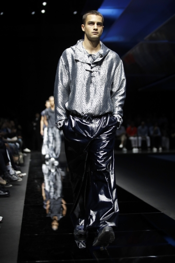 A model wears a creation as part of the Emporio Armani men's Spring-Summer 2020 collection, unveiled during the fashion week, in Milan, Italy, Saturday, June 15, 2019. (AP Photo/Luca Bruno)