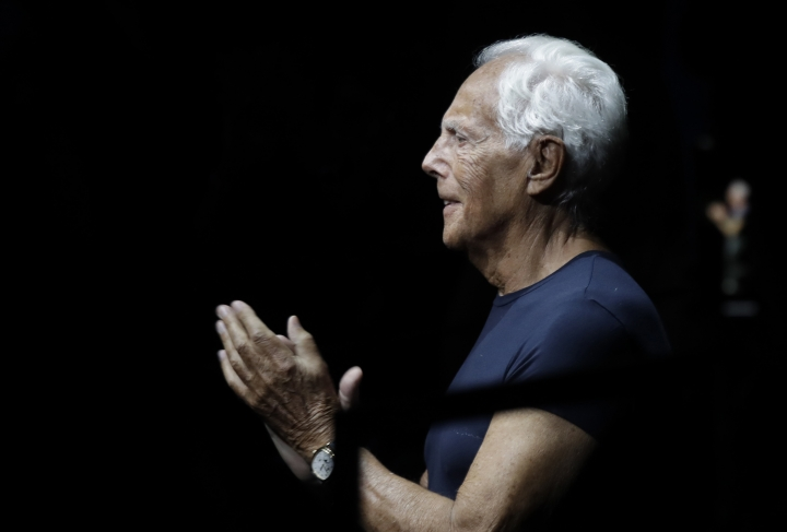 Designer Giorgio Armani accepts applause at the end of the Emporio Armani men's Spring-Summer 2020 collection, unveiled during the fashion week, in Milan, Italy, Saturday, June 15, 2019. (AP Photo/Luca Bruno)