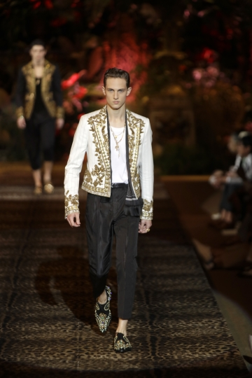 A model wears a creation as part of the Dolce & Gabbana men's Spring-Summer 2020 collection, unveiled during the fashion week, in Milan, Italy, Saturday, June 15, 2019. (AP Photo/Luca Bruno)