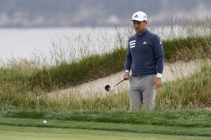 Xander Schauffele lines up a putt on the 17th hole during the third round of the U.S. Open Championship golf tournament Saturday, June 15, 2019, in Pebble Beach, Calif. (AP Photo/David J. Phillip)