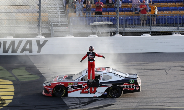 Christopher Bell celebrates after winning a NASCAR Xfinity Series auto race, Sunday, June 16, 2019, at Iowa Speedway in Newton, Iowa. (AP Photo/Charlie Neibergall)