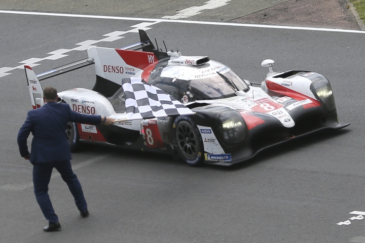 The Toyota TS050 Hybrid No8 of the Toyota Gazoo Racing Team driven by Kazuki Nakajima of Japan crosses the finish line to win the 87th 24-hour Le Mans endurance race, in Le Mans, western France, Sunday, June 16, 2019. (AP Photo/David Vincent)