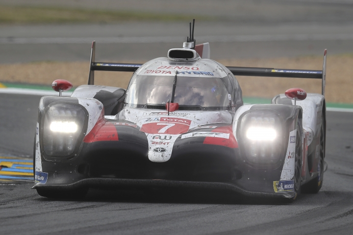 The Toyota TS050 Hybrid No7 of the Toyota Gazoo Racing Team driven by Kamui Kobayashi of Japan races during the 87th 24-hour Le Mans endurance race, in Le Mans, western France, Sunday, June 16, 2019. (AP Photo/David Vincent)
