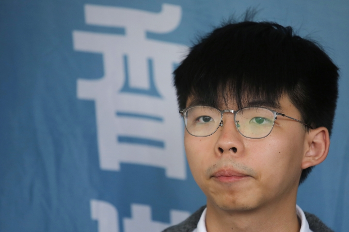 FILE - In this May 16, 2019, file photo, Pro-democracy activist Joshua Wong speaks to media at a court in Hong Kong. Members of his Demosisto party say the Hong Kong activist Wong, a leading figure in the 2014 Umbrella Movement, is to be released from prison. Wong's release from the Lai Chi Kok Correctional Facility comes as student demonstrators were facing off Monday, June 17, against police following a massive protest on Sunday. (AP Photo/Kin Cheung, File)