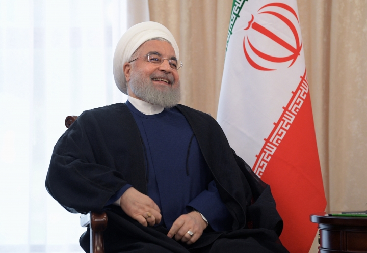 Iranian President Hassan Rouhani smiles as he speaks to Russian President Vladimir Putin during their talks on a sideline of the Shanghai Cooperation Organization summit in Bishkek, Kyrgyzstan, Friday, June 14, 2019. Iran's President Hassan Rouhani has called for closer cooperation between Tehran and Moscow amid rising regional tensions. (Alexei Druzhinin, Sputnik, Kremlin Pool Photo via AP)