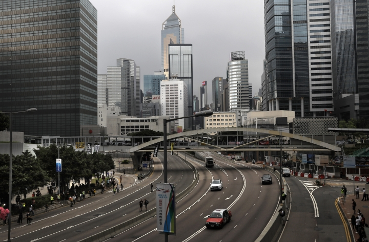 A downtown main road open as protesters leave the area near the Legislative Council following a massive protest against an extradition bill in Hong Kong, Monday, June 17, 2019. Protesters in Hong Kong have begun leaving the streets and gathering near the city's government headquarters. (AP Photo/Vincent Yu)