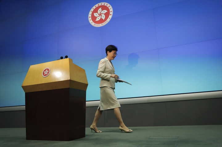 Hong Kong Chief Executive Carrie Lam leaves after a press conference at the Legislative Council in Hong Kong, Tuesday, June 18, 2019. Lam apologized Tuesday for an unpopular extradition bill that drew massive protests and indicated that it will not be revived during the current legislative session. (AP Photo/Kin Cheung)