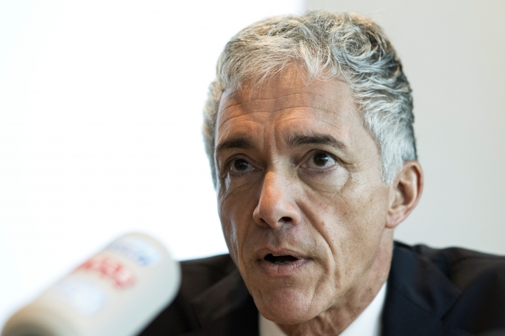 """FILE - In this Wednesday, Nov. 21, 2018 file photo, Switzerland's attorney general Michael Lauber briefs the media at a news conference in Bern, Switzerland. Switzerland's federal criminal court on Tuesday, June 18, 2019 says it recused attorney general Michael Lauber from overseeing a sweeping criminal investigation of FIFA officials. Former FIFA president Sepp Blatter, who has been a criminal suspect since September 2015 yet never charged, tells The Associated Press: """"Now I got part of my trust and confidence in the Swiss justice back."""" (Peter Schneider/Keystone via AP, file)"""
