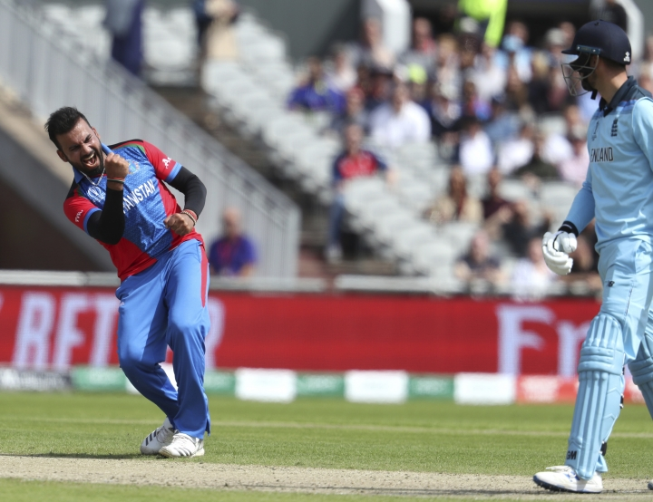 Afghanistan's Dawlat Zadran, left, celebrates the dismissal of England's James Vince, right, during the Cricket World Cup match between England and Afghanistan at Old Trafford in Manchester, England, Tuesday, June 18, 2019. (AP Photo/Rui Vieira)