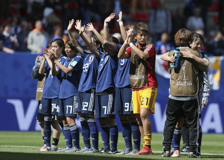 Japan's players celebrate after winning their Women's World Cup Group D soccer match between Japan and Scotland at the Roazhon Park in Rennes, France, Friday, June 14, 2019. (AP Photo/David Vincent)