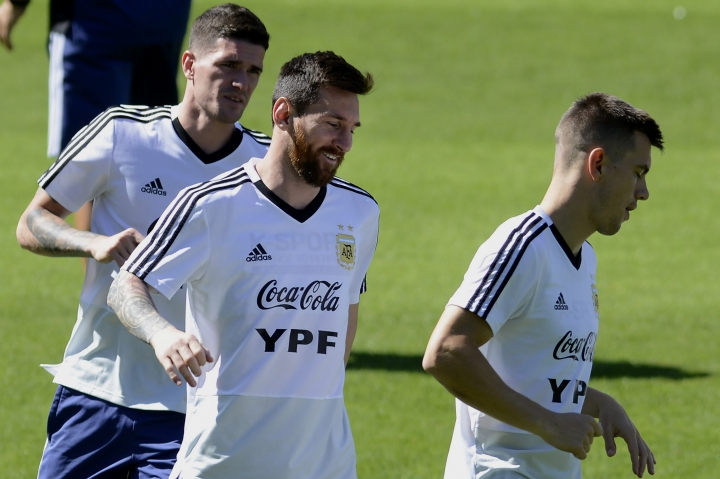 Argentina's Lionel Messi, center, warms up with teammates during a practice session of the national soccer team in Belo Horizonte, Brazil, Tuesday, June 18, 2019. Argentina will face Paraguay tomorrow in a Copa America Group B soccer match. (AP Photo/Eugenio Savio)