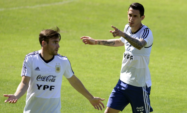 Argentina's Angel Di Maria, right, talks with teammate Nicolas Tagliafico during a practice session of the national soccer team in Belo Horizonte, Brazil, Tuesday, June 18, 2019. Argentina will face Paraguay tomorrow in a Copa America Group B soccer match. (AP Photo/Eugenio Savio)