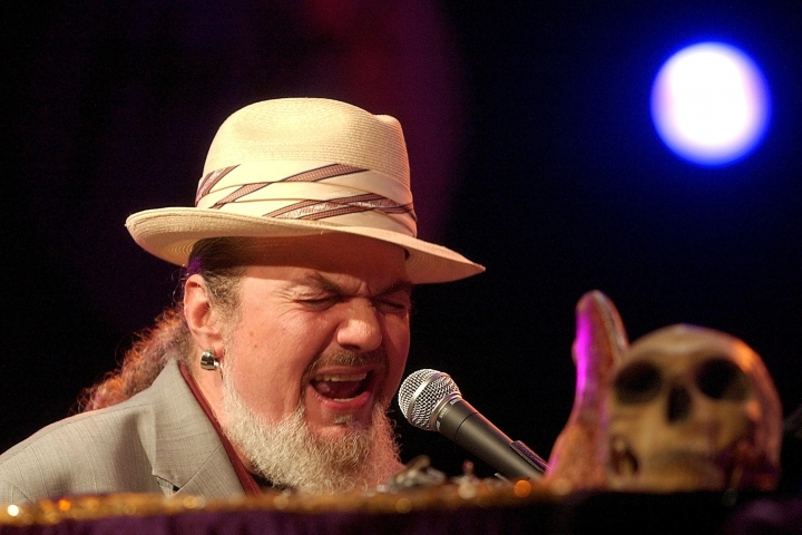 FILE - In this July 6, 2004 file photo, the legendary American Jazz performer, Dr. John, performs on the Auditorium Stravinski stage, during the 38th Montreux Jazz Festival, in Montreux, Switzerland. The family of the Louisiana-born musician known as Dr. John says the celebrated singer and piano player who blended black and white musical influence with a hoodoo-infused stage persona and gravelly bayou drawl, has died. He was 77. A family statement released by his publicist says Dr. John, who was born Mac Rebennack, died early Thursday of a heart attack. (Photo/Keystone/Sandro Campardo, File)