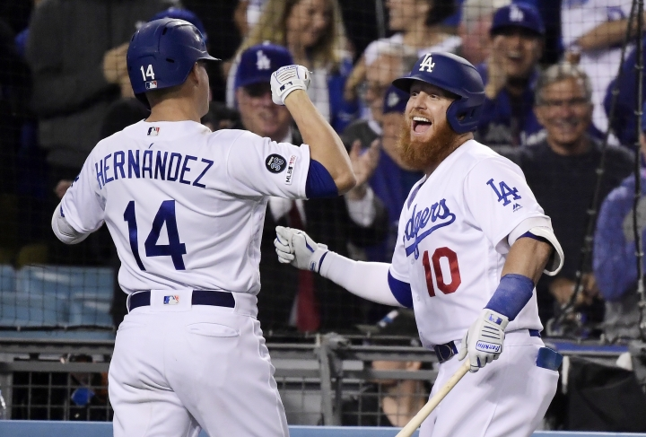 Los Angeles Dodgers' Enrique Hernandez, left, celebrates his grand slam with Justin Turner seventh inning of the team's baseball game against the San Francisco Giants on Tuesday, June 18, 2019, in Los Angeles. (AP Photo/Mark J. Terrill)