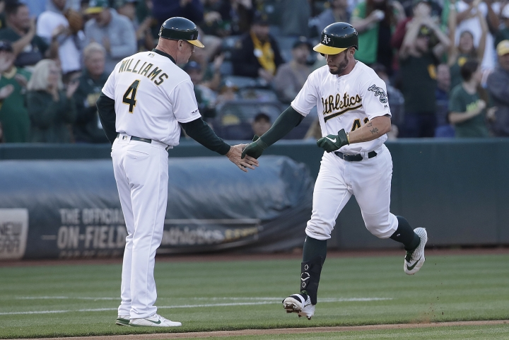 Oakland Athletics' Beau Taylor, right, is congratulated by third base coach Matt Williams after hitting a solo home run against the Baltimore Orioles during the third inning of a baseball game in Oakland, Calif., Tuesday, June 18, 2019. (AP Photo/Jeff Chiu)