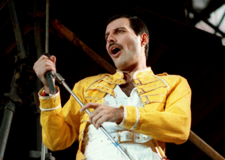 "FILE - In this July 20, 1986 file photo, Queen lead singer Freddie Mercury performs, in Germany. A previously unheard and unreleased song by Mercury was released Thursday, June 20, 2019. Universal Music announced that the track, ""Time Waits for No One,"" was originally recorded in 1986 for the concept album of the musical ""Time"" with musician Dave Clark. A video to accompany the song was also released and includes unseen performance footage of Mercury. It was recorded in April 1986 at London's Dominion Theatre. (AP Photo/Marco Arndt, File)"