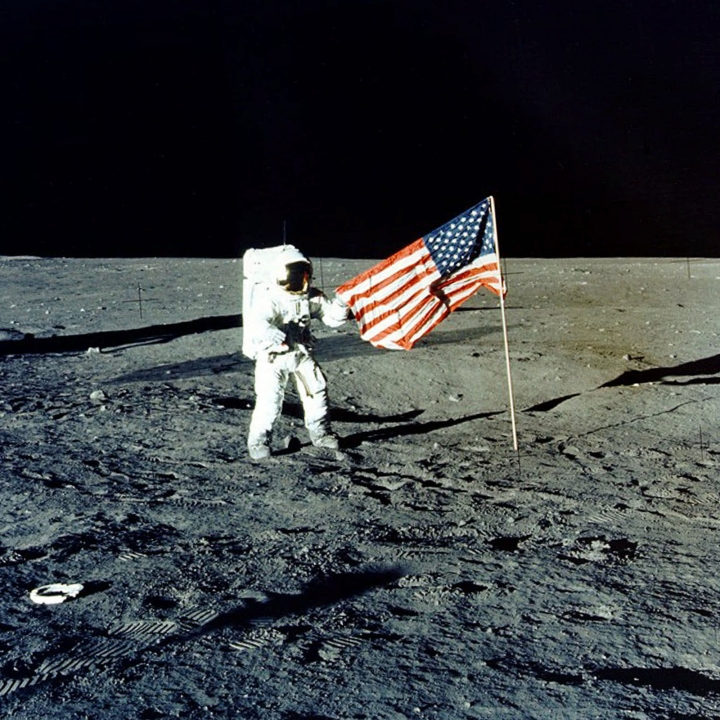 "FILE - In this Nov. 1969 photo made available by NASA, Apollo 12 mission Commander Charles P. ""Pete"" Conrad stands on the moon's surface. A poll released Thursday, June 20, 2019 shows that Americans prefer a space program focusing on potential asteroid impacts, scientific research into our cosmos and robotic space probes over human exploration of Mars or the moon. (AP Photo/NASA)"